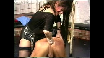 Mistress with smoking fetish dominates slave wearing sexy leather gloves
