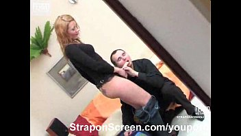 Raven haired babe in thigh high boots strapon fucks her blonde friend